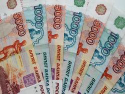 Рубль в январе немного снизился к доллару и евро