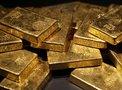Золото поблекло на фоне кризиса