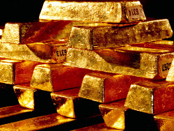Золото дешевеет в ожидании новостей из Германии