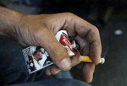 Картинки с последствиями курения появятся на пачках с июля