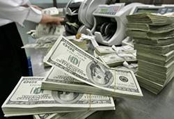Эксперт: резкий рост доллара закончится с возвращением старых цен на нефть