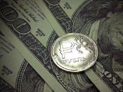 Эксперт озвучил прогноз по курсу рубля к евро и доллару на  август