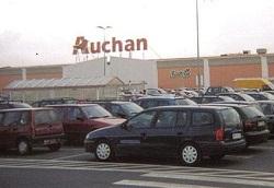 Auchan  проглотит  гипермаркеты Real