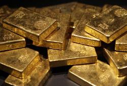 Цена на золото откатилась вниз после бурного роста